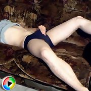 Shy teen lad holds on to his large ripe balls while j..